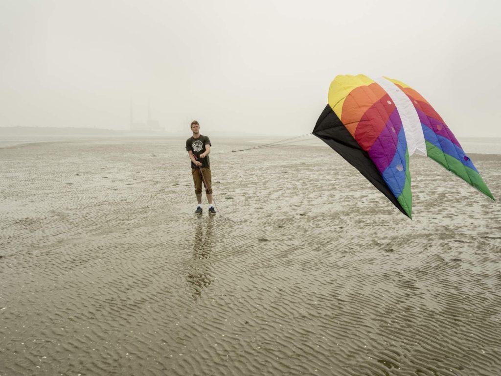 Guy flying a kite on Sandymount Beach, Dublin